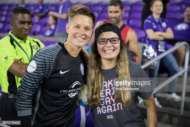 Orlando Pride goalkeeper Ashlyn Harris takes a picture with a fan after the NWSL soccer match between the Orlando Pride and Sky Blue FC on August 12...