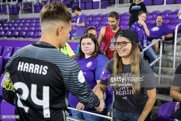 Orlando Pride goalkeeper Ashlyn Harris talks with a fan after the NWSL soccer match between the Orlando Pride and Sky Blue FC on August 12 2017 at...