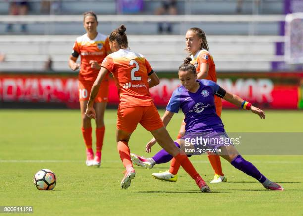 Orlando Pride midfielder Camila Pereira blocks Houston Dash defender Poliana Barbosa Medeiros pass during the NWSL soccer match between the Orlando...