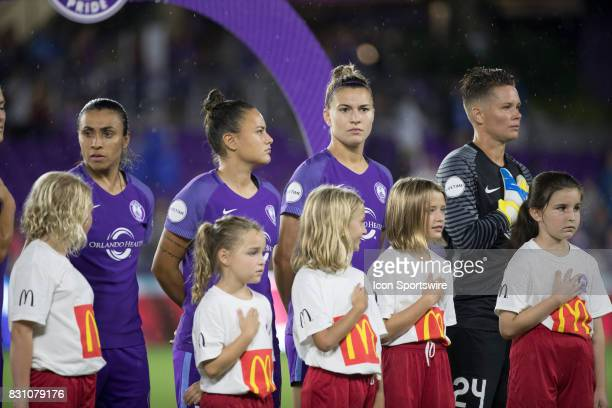 Orlando Pride players during the National Anthem before the NWSL soccer match between the Orlando Pride and Sky Blue FC on August 12 2017 at Orlando...