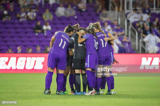 Orlando Pride players huddle during the NWSL soccer match between the Orlando Pride and Sky Blue FC on August 12 2017 at Orlando City Stadium in...