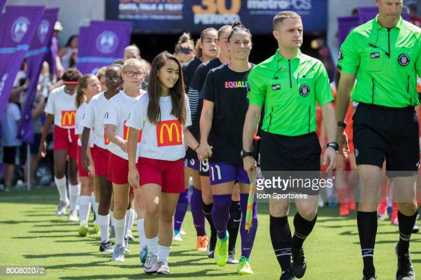 Orlando Pride players walk on to the pitch wearing special shirts supporting equality before the NWSL soccer match between the Houston Dash and...
