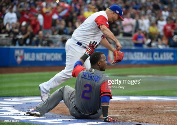Orlando Roman of Puerto Rico reacts after Jean Segura of the Dominican Republic was tagged out at the plate during the first inning of World Baseball...