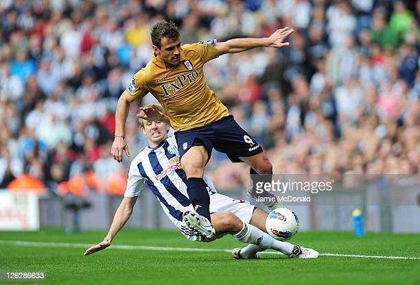 Orlando Sa of Fulham and Gareth McAuley of West Brom compete during the Barclays Premier League match between West Bromwich Albion and Fulham at the...