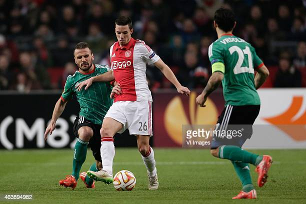 Orlando Sa of Legia Warszawa Nick Viergever of Ajax during the round of 32 UEFA Europa League match between Ajax and Legia Warsaw on February 19 2015...