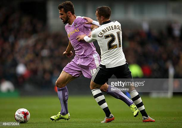 Orlando Sa of Reading holds off pressure from Lasse Vigen Christensen of Fulham during the Sky Bet Championship match between Fulham and Reading on...