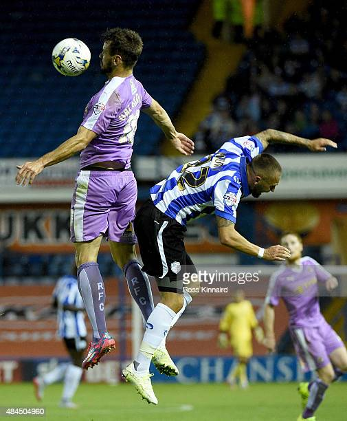 Orlando Sa of Reading is challenged by Jack Hunt of Sheffield Wednesday during the Sky Bet Championship match between Sheffield Wednesday and Reading...