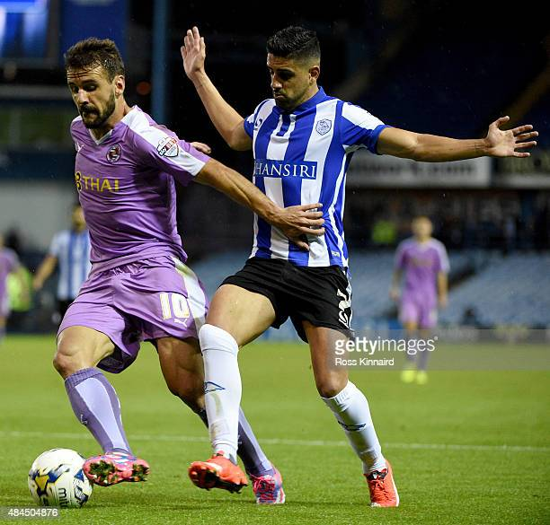 Orlando Sa of Reading is challenged by Marco Matias of Sheffield Wednesday during the Sky Bet Championship match between Sheffield Wednesday and...