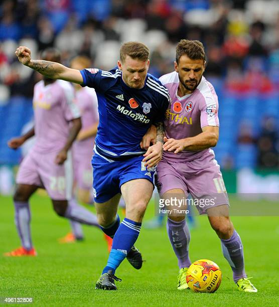 Orlando Sa of Reading is tackled Aron Gunnarsson of Cardiff City during the Sky Bet Championship match between Cardiff City and Reading at the...