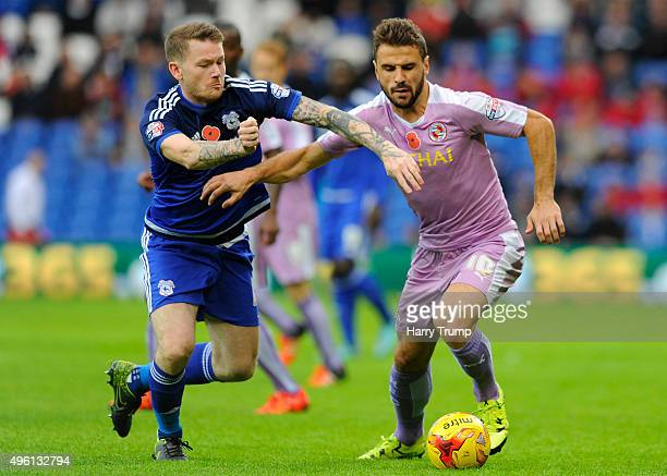 Orlando Sa of Reading is tackled by Aron Gunnarsson of Cardiff City during the Sky Bet Championship match between Cardiff City and Reading at the...