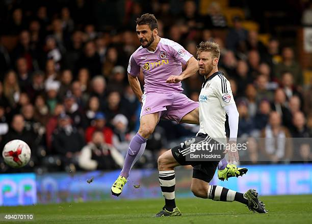 Orlando Sa of Reading scores his team's second goal of the game under pressure from Tim Ream of Fulham during the Sky Bet Championship match between...