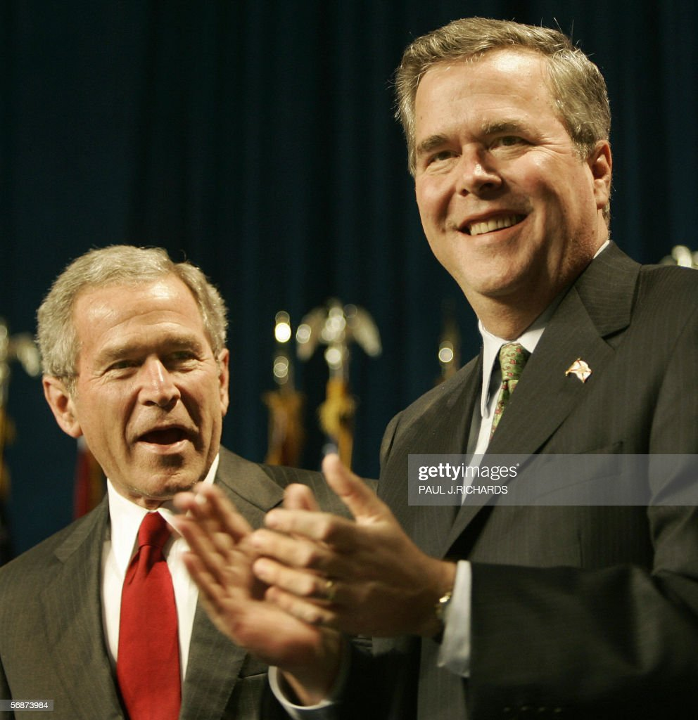 US President George W Bush is introduced by his brother Florida Governor Jeb Bush before the Republican Party of Florida Dinner 17 February 2006...