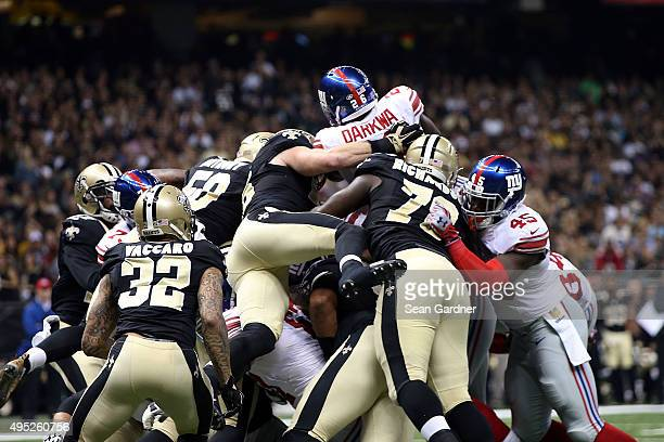 Orleans Darkwa of the New York Giants tries to leap over the defense during the second quarter of a game against the New Orleans Saints at the...