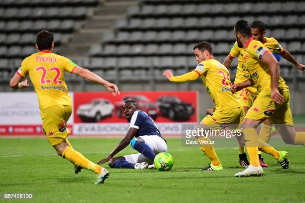 Orleans defend in numbers as Soualio Bakayoko of Paris FC cannot find a way through during the Playoff match between Paris Fc and Us Orleans at Stade...