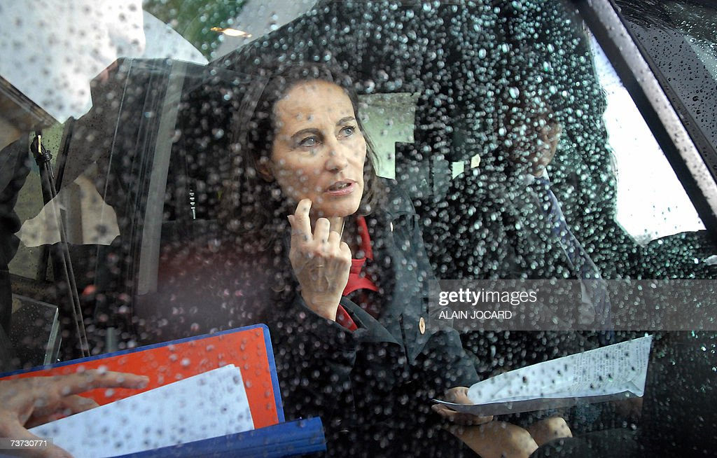 French socialist candidate for the next presidential elections Segolene Royal gets in her car after visiting professionnal school as part of her campaign, 28 March 2007 in Orleans, central France. Commenting on the actions of police who used tear-gas and baton charges to control scores of rioters in a crowded Paris railway station last night, Royal said Today it showed 'the complete failure of the right-wing power since 2002 in terms of security policy'. AFP PHOTO ALAIN JOCARD