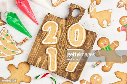 Ornament icing of Christmas gingerbreads on a white background : Stock Photo