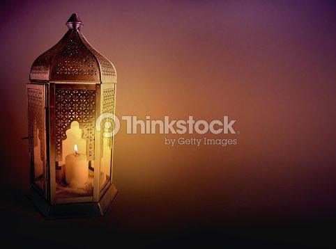 Ornamental arabic lantern with burning candle glowing at night ornamental arabic lantern with burning candle glowing at night greeting card invitation for muslim m4hsunfo
