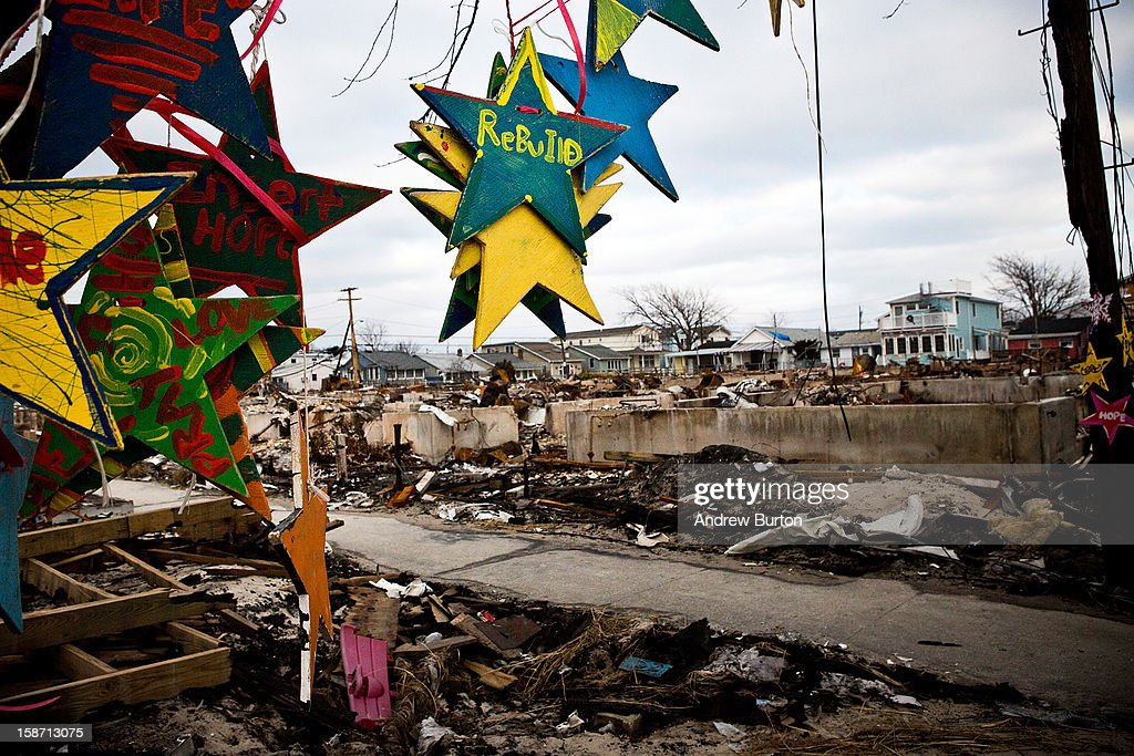 Ornaments hangs on a burned tree December 25, 2012 in the Breezy Point neighborhood of the Queens borough of New York City. Residents are still struggling to recover from a massive fire that destroyed over 100 homes during Superstorm Sandy.