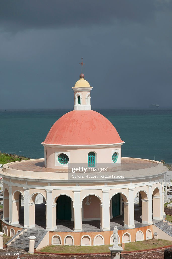 Ornate dome overlooking ocean : Stock Photo