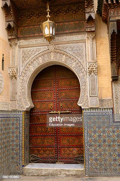 Ornate door of Sidi Ahmed Tijani Mosque with intricate stone carving in Fes Morocco