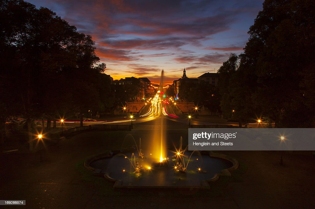 Ornate fountain with traffic at night : Stock Photo
