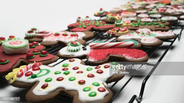Ornate gingerbread man cookies on baking tray