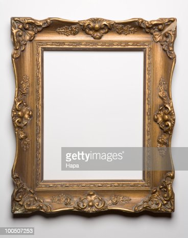 Ornate gold frame against white background : Stock Photo
