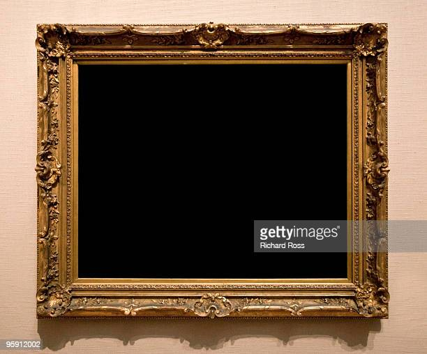 Ornate Gold Frame on a Brown Wall