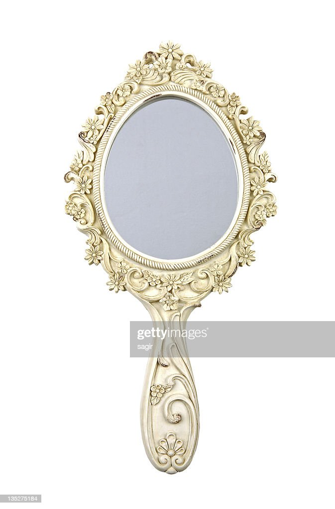 Ornate hand mirror Oval Ornate Gold Hand Mirror With Flowers Stock Photo Thinkstock Ornate Gold Hand Mirror With Flowers Stock Photo Thinkstock
