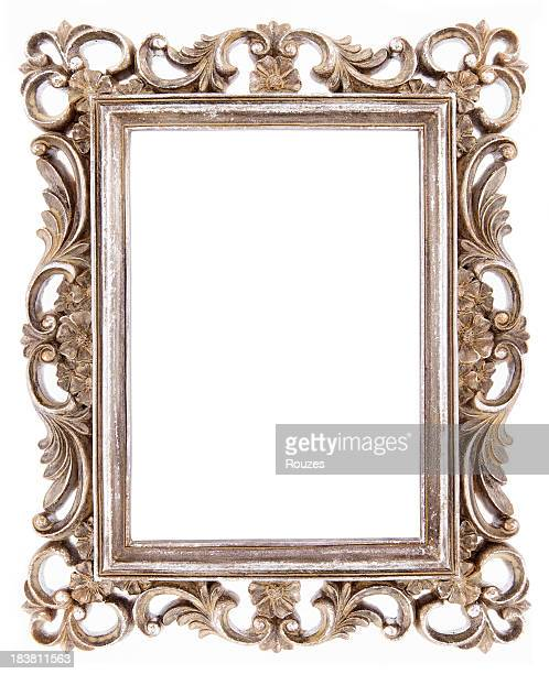 Ornate golden frame isolated on white background