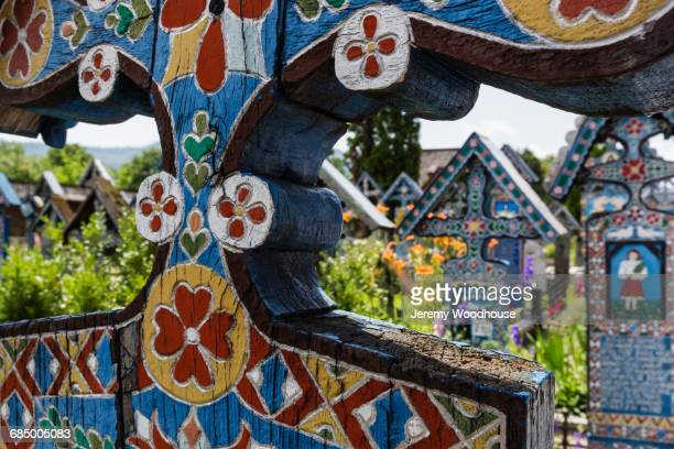Ornate painted cross in cemetery, Sapanta, Maramures, Romania