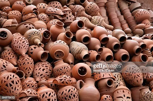 Ornate pots stacked outside pottery in Morocco.