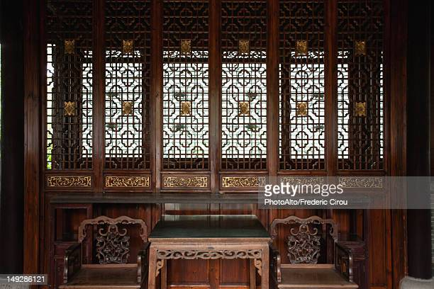 Ornately carved wooden screen, table and chairs