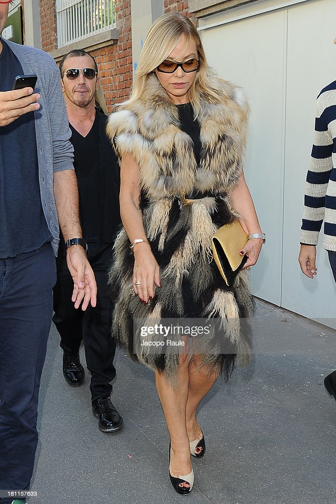 <a gi-track='captionPersonalityLinkClicked' href=/galleries/search?phrase=Ornella+Muti&family=editorial&specificpeople=208764 ng-click='$event.stopPropagation()'>Ornella Muti</a> is seen leaving the Fendi during Milan Fashion Week Womenswear Spring/Summer 2014 on September 19, 2013 in Milan, Italy.