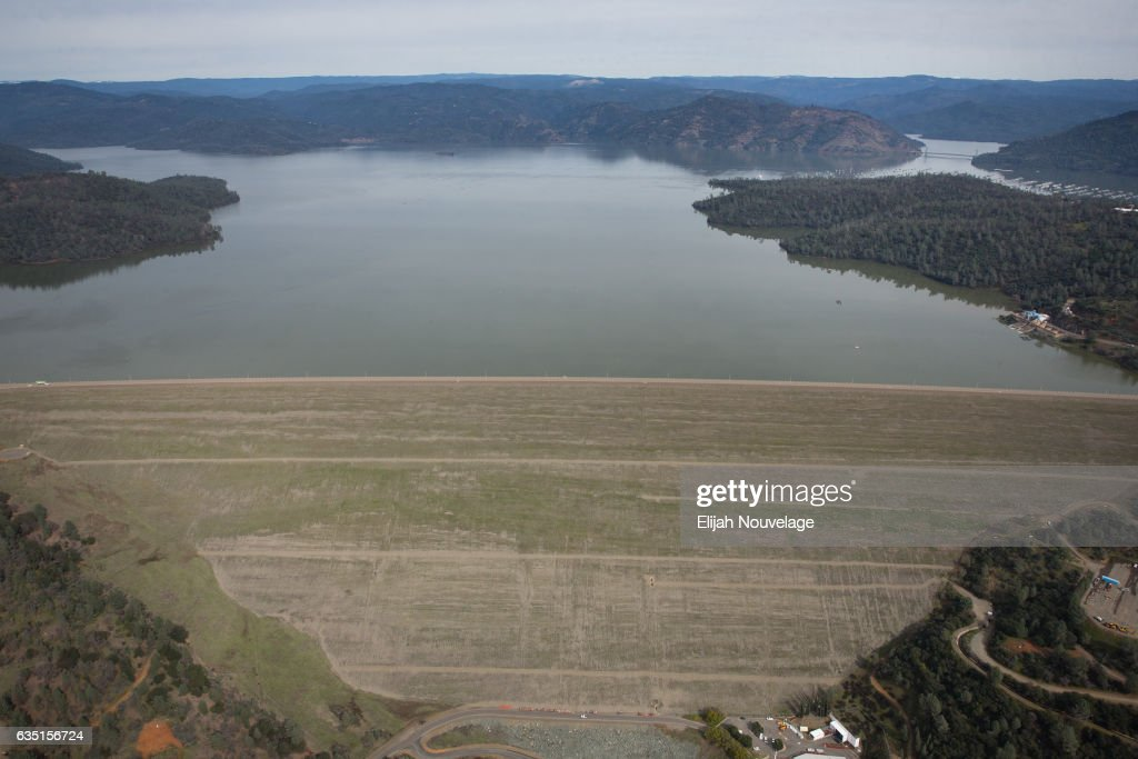 Oroville Lake and its spillways are seen from the air on February 13, 2017 in Oroville, California. Almost 200,000 people were ordered to evacuate the northern California town after a hole in an emergency spillway in the Oroville Dam threatened to flood the surrounding area.