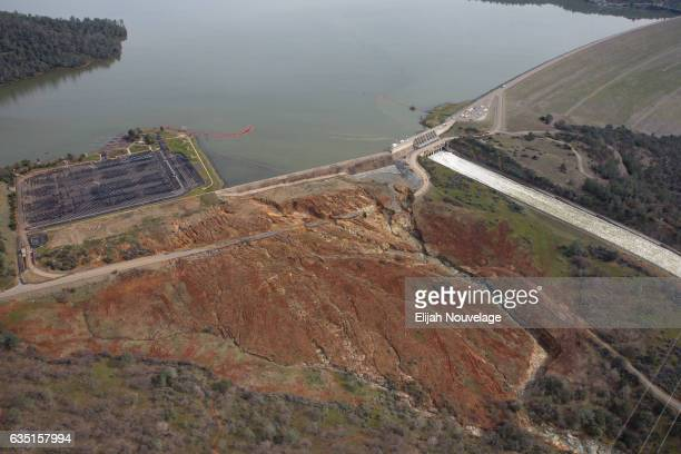 Oroville lake the emergency spillway and the damaged main spillway are seen from the air on February 13 2017 in Oroville California The erosion...