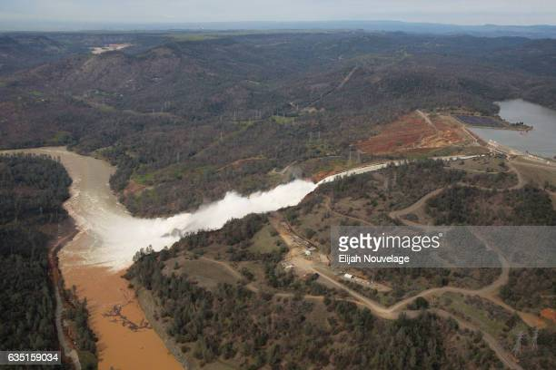 Oroville lake the emergency spillway and the damaged main spillway are seen from the air on February 13 2017 in Oroville California Almost 200000...
