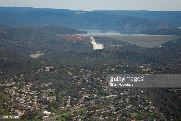 Oroville lake the emergency spillway the damaged main spillway and the earthen Oroville Dam are seen behind the town of Oroville from the air on...