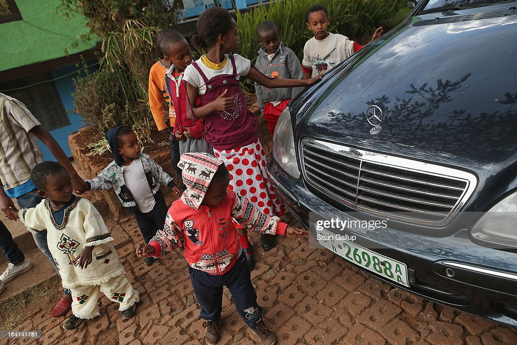 Orphan children admire the Mercedes limousine that brought German First Lady Daniela Schadt for a visit at the AGOHELD orphanage, hospital, training center and school, founded by Abebech Gobena, on March 19, 2013 in Addis Ababa, Ethiopia. Ababech Gobena started the orphanage in 1980 and has since received help from both Ethiopian and international organizations, especially UNICEF, to expand the project to communities across Ethiopia. Ethiopia, with an estimated 91 million inhabitants, is the second most populated country in Africa and the per capita income is $1,200.
