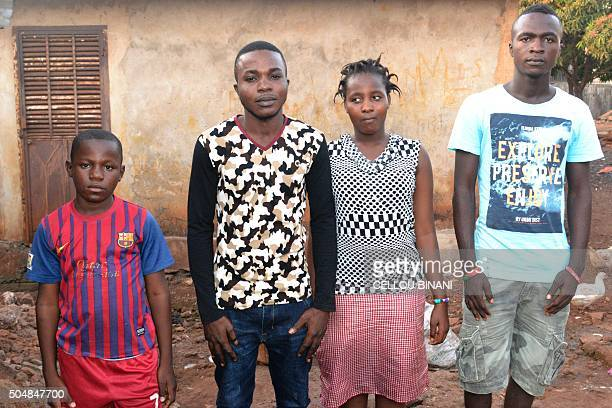 Orphan children Ousmane Tamba Emmanuel Hawa and Saa Mathias Lenoh pose on January 12 at their home in Conakry According to the United Nations more...