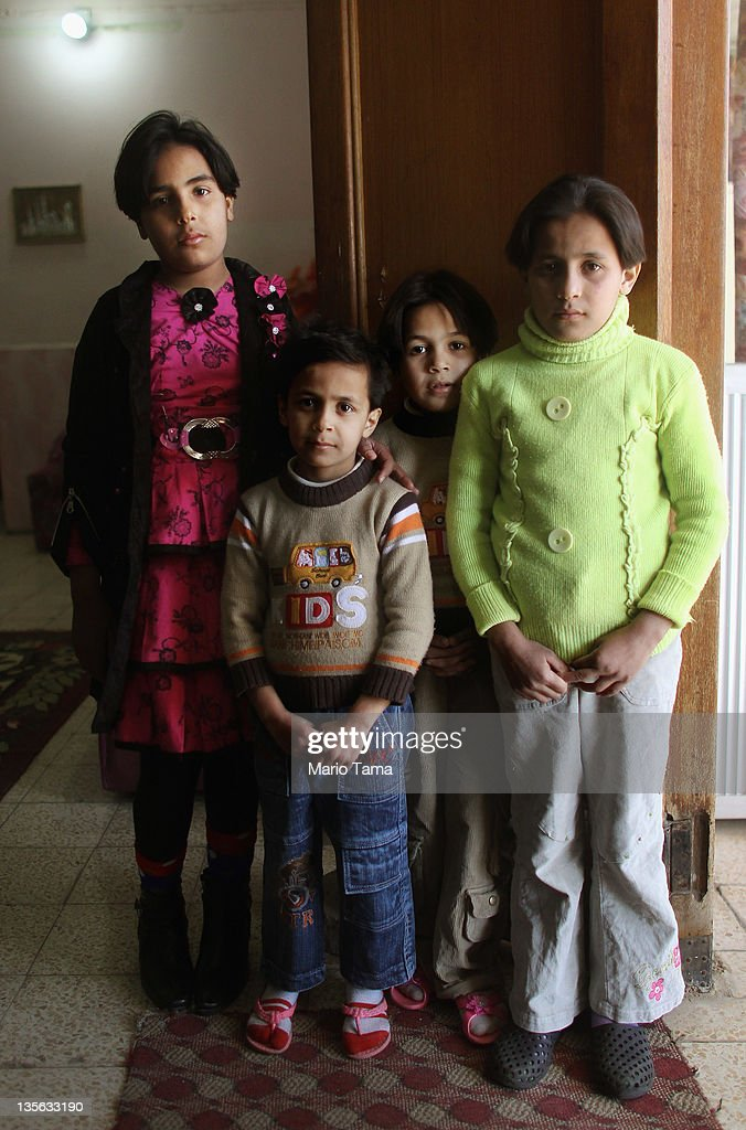 Orphaned sisters (L to R) Nabaa, Lubna, Doha and Suha Qais stand in the orphanage where they now live on December 12, 2011 in Baghdad, Iraq. The sisters were orphaned when their parents were kidnapped and killed during post-invasion sectarian violence in Baqouba. Estimates suggest there may be more than one million orphans currently in the country, with many having lost parents to war-related violence. Iraq is transitioning nearly nine years after the 2003 U.S. invasion and subsequent occupation. American forces are now in the midst of the final stage of withdrawal from the war-torn country. At least 4,485 U.S. military personnel have died in service in Iraq. According to the Iraq Body Count, more than 100,000 Iraqi civilians have died from war-related violence.