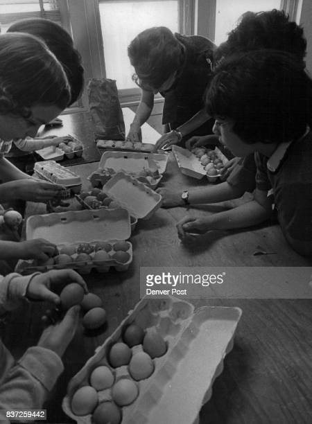 Orphans Get Easter Treat Easter eggs are decorated Thursday by some of 22 girls from Queen of Heaven Orphanage 4825 Federal Blvd and their hosts the...
