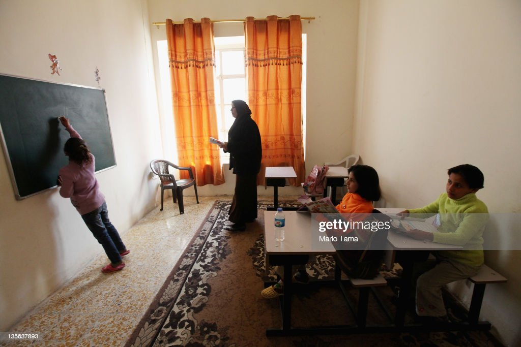 Orphans take a class in an orphanage on December 12, 2011 in Baghdad, Iraq. Estimates suggest there may be more than one million orphans currently in the country, with many having lost parents to war-related violence. Iraq is transitioning nearly nine years after the 2003 U.S. invasion and subsequent occupation. American forces are now in the midst of the final stage of withdrawal from the war-torn country. At least 4,485 U.S. military personnel have died in service in Iraq. According to the Iraq Body Count, more than 100,000 Iraqi civilians have died from war-related violence.