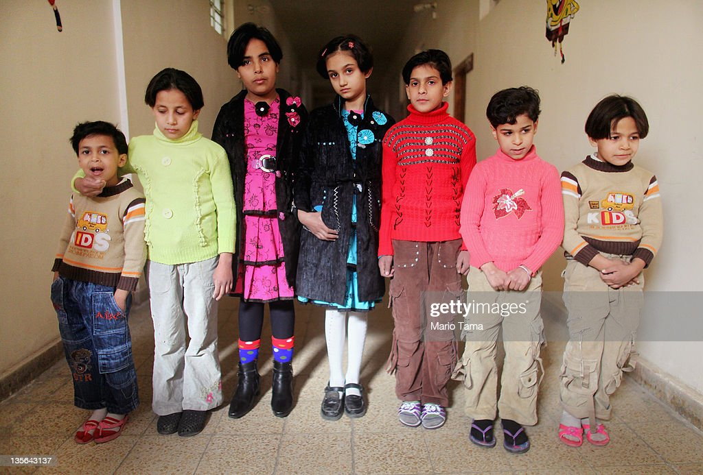 Orphans who lost parents in war-related violence (L to R) Lubna Qais, Suha Qais, Nabaa Qais, Randa Monam, Marwa Hassan, Warud Walid and Doha Qais stand in the orphanage where they now live on December 12, 2011 in Baghdad, Iraq. Estimates suggest there may be more than one million orphans currently in the country, with many having lost parents to war-related violence. Iraq is transitioning nearly nine years after the 2003 U.S. invasion and subsequent occupation. American forces are now in the midst of the final stage of withdrawal from the war-torn country. At least 4,485 U.S. military personnel have died in service in Iraq. According to the Iraq Body Count, more than 100,000 Iraqi civilians have died from war-related violence.