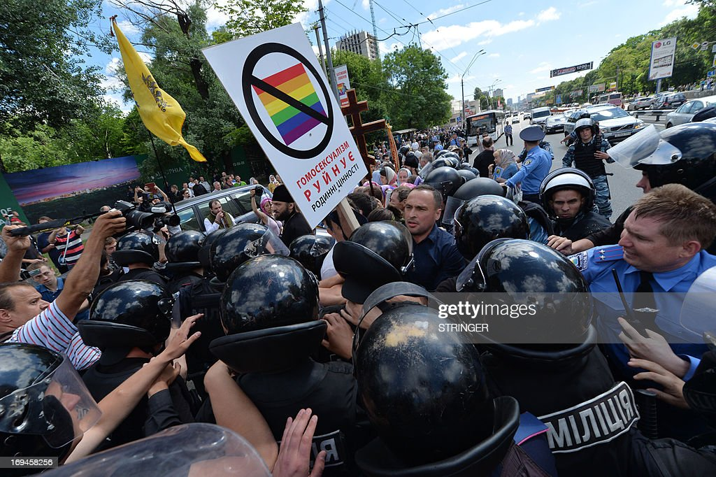 Orthodox believers clash with police as they protest against a Gay Parade in Kiev on May 25, 2013. Around a hundred gay rights activists marched in Ukraine on Saturday despite fears of violence and a court ban, the post-Soviet country's first ever gay pride event.