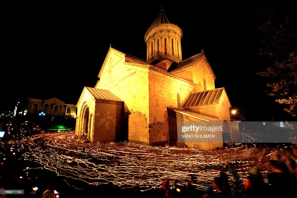 Orthodox believers walk around the Sion Cathedral holding candles as they celebrate Easter in Tbilisi early on May 5, 2013.