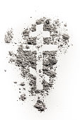 Orthodox christian crucifix or cross symbol drawing in ash, dust or sand as lent fasting and abstinence time in desert of jesus before easter