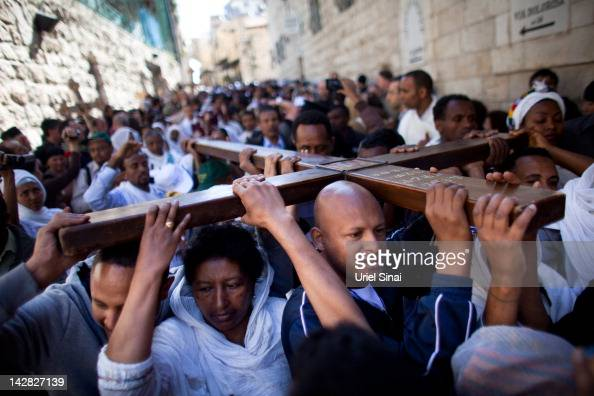Orthodox Christian pilgrims hold wooden crosses as they take part in the Good Friday procession along the Via Dolorosa ahead of Orthodox Easter on...
