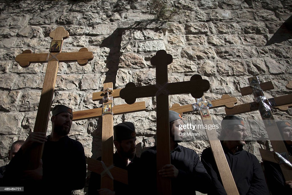Orthodox Christian pilgrims hold wooden crosses as they take part in the Good Friday procession along the Via Dolorosa on April 18, 2014 in Jerusalem's old city, Israel.Thousands of Christian pilgrims from around the world have flocked to the Holy City to mark Good Friday and pray along the traditional route Jesus Christ took to his crucifixion, leading up to his resurrection on Easter.