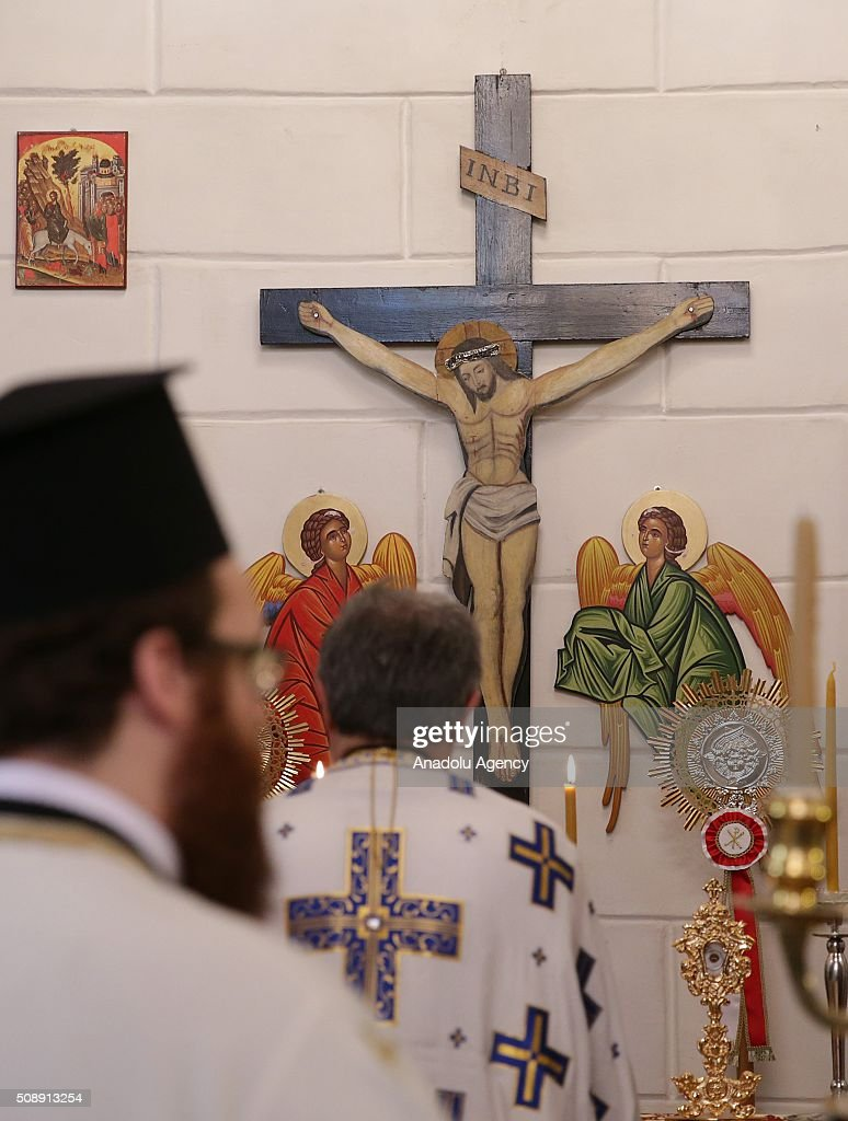 Orthodox Christians attend a Sunday mass which was led by Fener Greek Patriarch Bartholomeos at Aya Fotini os Church in Konak district of Izmir, Turkey on February 7, 2016.